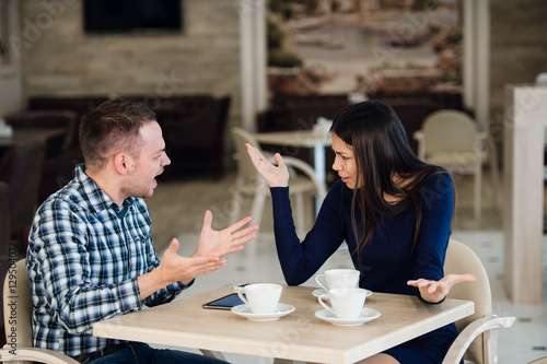 Young couple arguing in a cafe Canvas Print