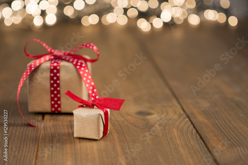 christmas gifts on wood light background