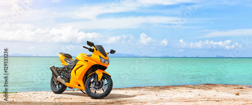 Poster Motorsport Panoramic scene of sport motorcycle at the beach