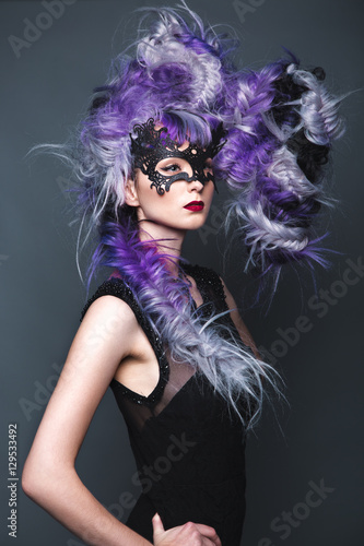 Fotografiet Beautiful girl in evening dress with avant-garde hairstyles