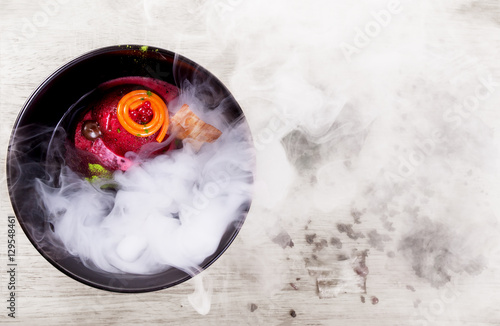 Molecular Cuisine. Delicious soup with beetroot. Canvas Print