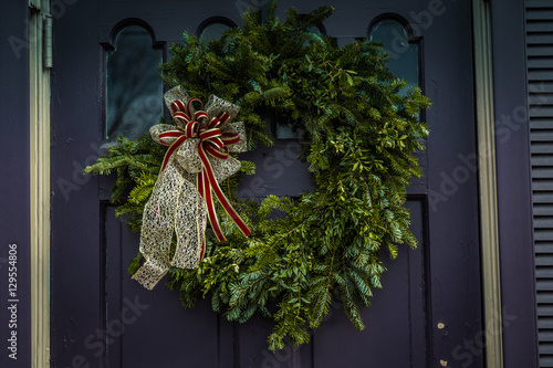 Evergreen Christmas Wreath On Purple Door Buy This Stock Photo And