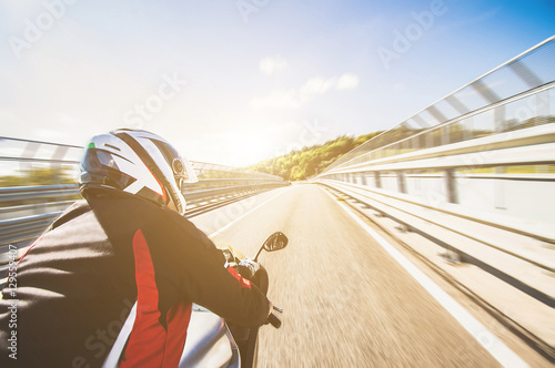 Motorcyclist riding his bike on the road at high speed Wallpaper Mural