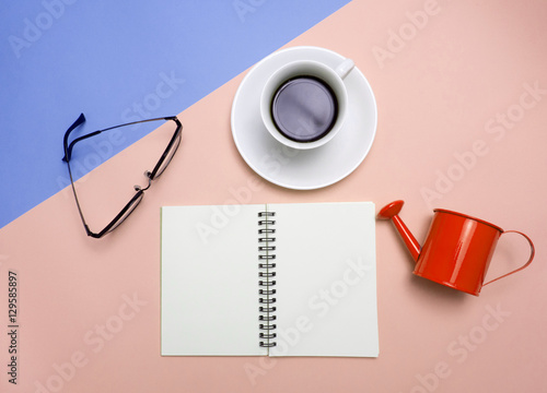 Fototapeta Top view of colorful cup of coffee and glasses  on color  background for create idea for business or design .Relax coffee time (flat lay) obraz na płótnie