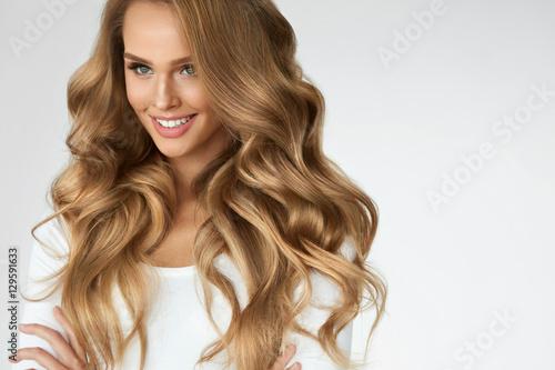 Fényképezés  Beautiful Curly Hair. Girl With Wavy Long Hair Portrait. Volume