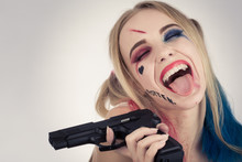 Cosplayer Girl In Harley Quinn Makeup And Costume