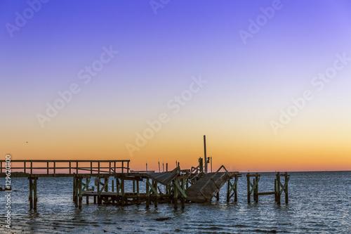 Foto auf AluDibond Pier Hurricane damage to a pier in Cedar Key, Florida