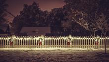 Seasonal Christmas Decoration On White Fence