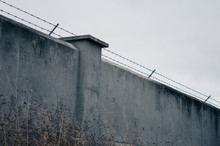 Cold Cement Wall With Barbed Wire