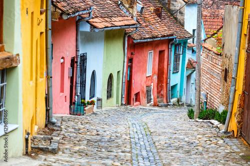Fotografie, Obraz  Medieval street view in Sighisoara, Romania