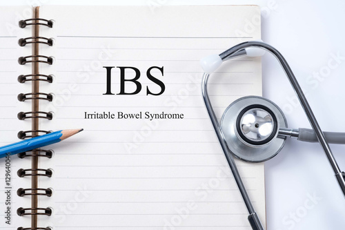 Valokuva  Notebook and pencil  with IBS (Irritable Bowel Syndrome) on the