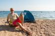 Man camping at the beach