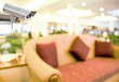 CCTV Camera on abstract blur beautiful hotel lobby background concept idea.