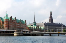 Panoramic View On Christiansborg Palace And Stock Exchange Over The Channel In Copenhagen, Denmark