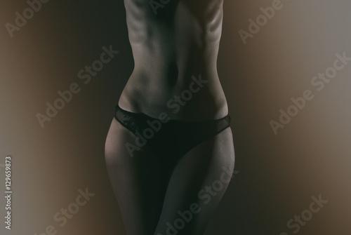 Fototapeta Front view of slim female body in black panties. obraz na płótnie