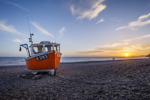 Fishing Boat Moored On Branscombe Beach At Sunset, Seaton, East Devon