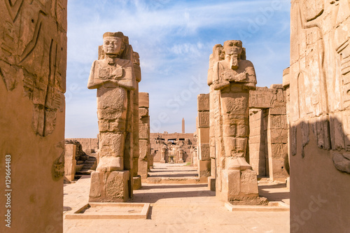 Wall Murals Place of worship LUXOR, EGYPT: Ancient ruins of Karnak temple in Egypt at noon. The complex is a vast open-air museum, and the second largest ancient religious site in the world