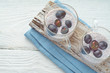Chia pudding with grapes on the white wooden table