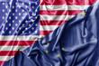 Ruffled waving United States of America and Alaska flag