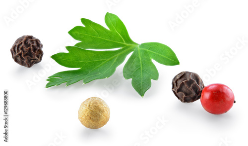 Fototapeta Herbs and spice. Black, red, white pepper and parsley isolated o obraz