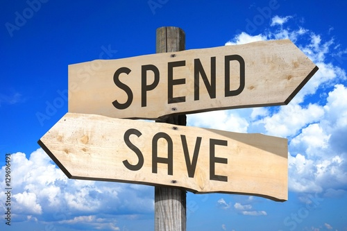 Spend, save - wooden signpost Canvas-taulu