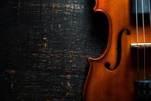 Violin On Wooden Dark Background