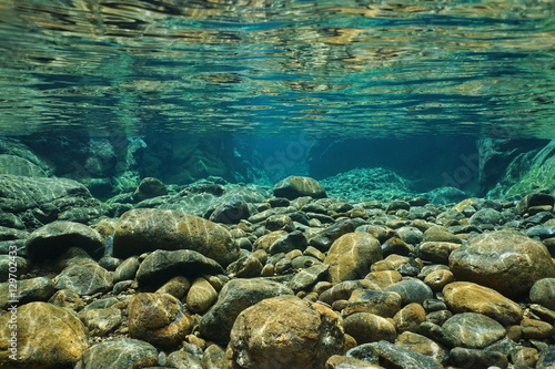 plakat Rocks underwater on riverbed with clear freshwater, Dumbea river, Grande Terre, New Caledonia