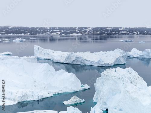 Fotobehang Gletsjers glaciers are melting on arctic ocean in Greenland