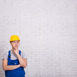 builder in uniform and copy space over white wall