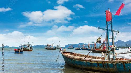 Fishing boat park at beach Canvas Print
