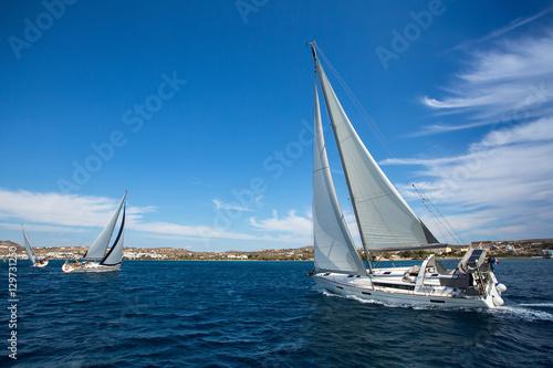 Luxury yachts at Sailing regatta. Sailing in wind through waves at Sea.