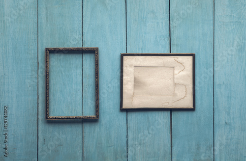 old frames on wooden wall