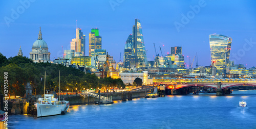 London cityscape at dusk with urban buildings over Thames River Wallpaper Mural