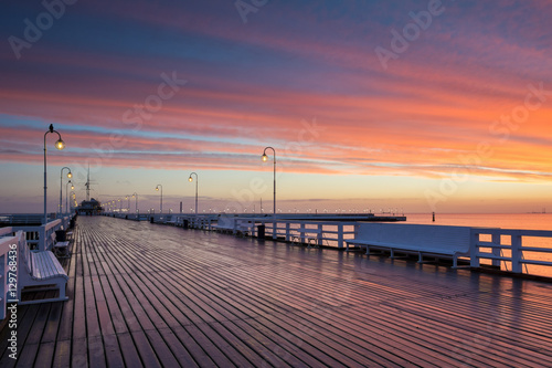 Pier in Sopot at sunrise time with amazing colorful sky. Poland. Europe.