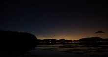 Timelapse Over Mash On Lopez Island With Stars And Ships And Town Lights