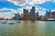 Skyline of Boston and floating boats during the sunny day
