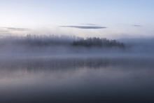 Fog On The Lake During Sunrise In Early Morning In Finland