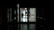 silhouette of doctors walking through hospital hallway, night duty