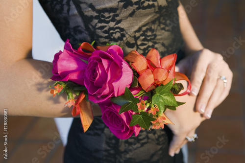 Photographie Teenage girl wearing corsage close-up of flowers