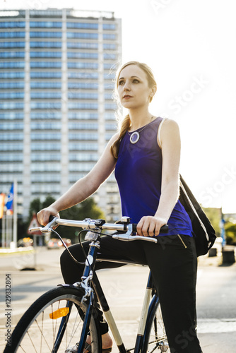 Germany, Berlin, Woman on bicycle in city