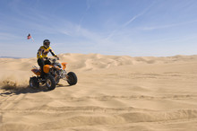 Young Man Riding Quad Bike In ...
