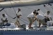 canvas print picture - Side view of crew members working on sailboat