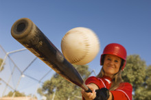 Middle Aged Caucasian Female Baseball Player Hitting A Shot