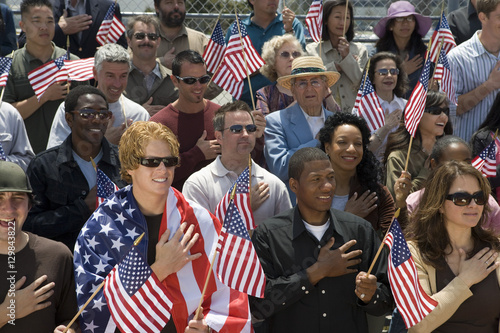 Group of multiethnic people singing American national anthem and holding America Canvas Print