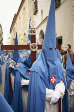 Hooded Penitents Around A Cros...