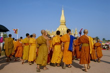 A Group Of Monks At The Annual Makka Bu Saa Buddhist Celebration, During Pha That Luang (Buddhist Lent), In Vientiane, Laos
