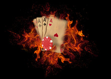Playing Cards And Chips On Fire. Casino Concept