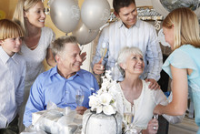 Happy Family Celebrating 25th Anniversary Of Parents