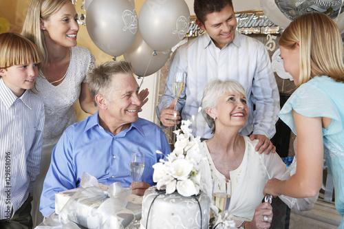 Obraz Happy family celebrating 25th anniversary of parents - fototapety do salonu