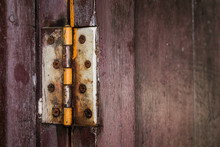 A Rust Hinge At The Old Wooden...